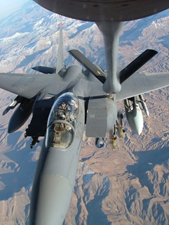 A Thirsty F15 Strike Eagle Gets Topped Off from a KC-135 Stratotanker fueling boom.