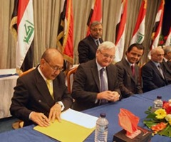 Vice President of Malaysia's Petronas Abdullah Karim (L) signs a contract for the Majnoon oil field in southern Iraq, Baghdad.